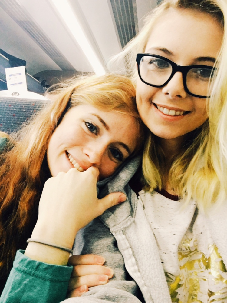 A photo has two smiling girls. The author leans her head on her girlfriend's shoulder.