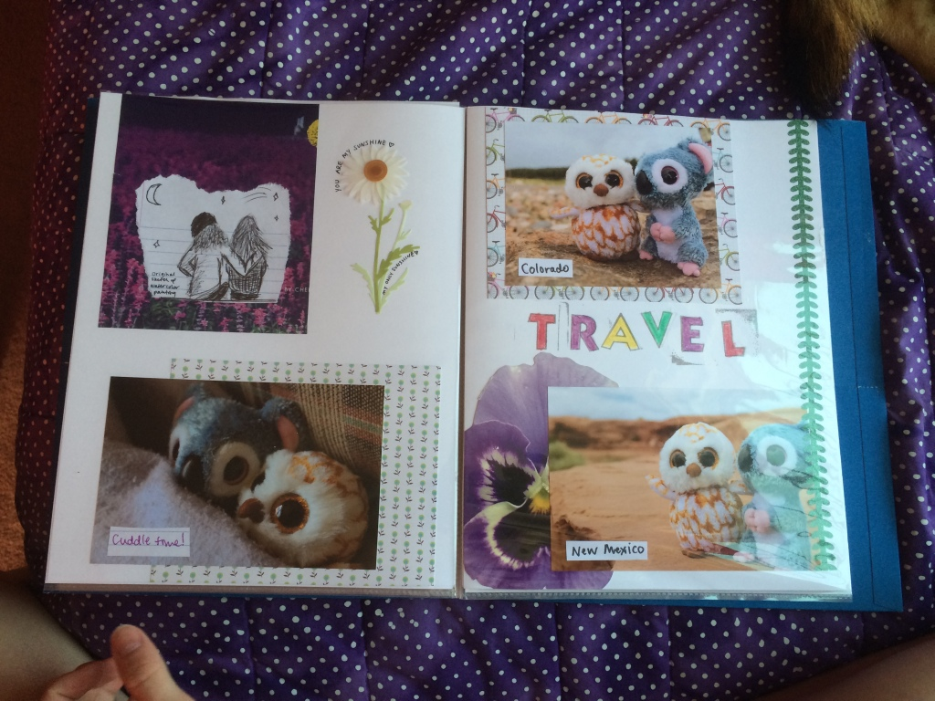 A scrapbook has two open pages. The first page includes a sketch of two girls looking at starts, a sticker of a daisy that says, you are my sunshine my only sunshine, and a photo of a koala and owl teddy close together under a blanket with the caption, cuddle time. Page 2 has the title, travel, and includes two photos. The first photo reveals the owl and koala teddies sitting together on a rock. The caption reads, Colorado. The second photo shows the owl and koala teddies on a sandy platform with dirt and rock stretching behind them. The caption reads, New Mexico.